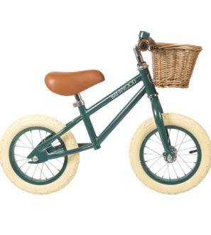 Banwood First Balance Bike in Dark Green with a basket & Bell perfect for a Childs first bike now available at Nurture Collective