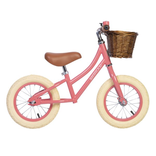 Side profile of the Banwood Balance Coral Bike with a basket & Bell perfect for childrens first bike now available at Nurture Collective