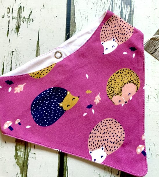 The Hedgehog Matching Baby Dribble bib an optional to add with the matching Leggings gift set with hat and mitts. This comes in a giftable drawstring bag by Maebelle & Bo available at Nurture Collective