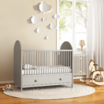 A baby's nursery with cot and mobile for sustainable nursery swaps blog at Nurture Collective
