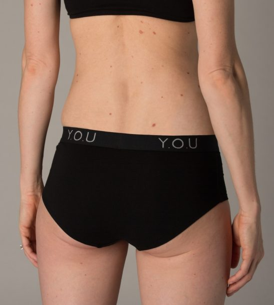 Woman Wearing The Women Branded Boy Shorts in Black Back View by YOU Underwear at Nurture Collective