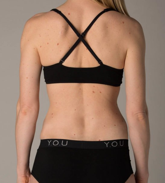 Woman Wearing the Black Thong & Crossover Bralette Set Front View by YOU Underwear at Nurture Collective