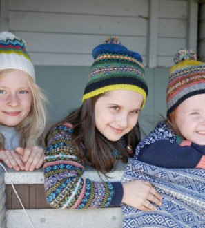Three kids leaning on stables doors wearing the Wayfinder Hats by the Faraway Gang at Nurture Collective