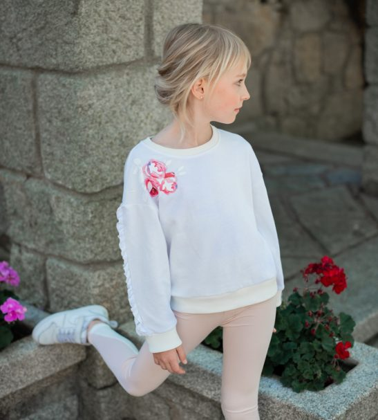 A girl wearing Fairy White Sweatshirt and Inversion leggings by Peter Jo at Nurture Collective