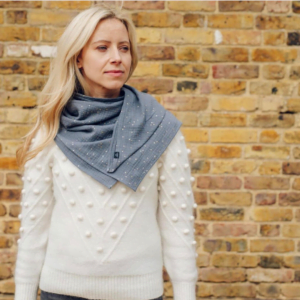 Woman wearing a Womens Grey Ponchlin Scarf at Nurture Collective