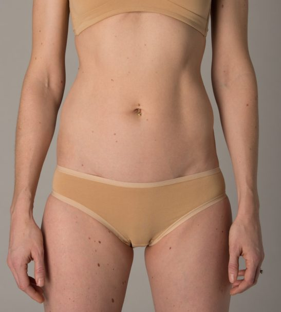 Front view of Model wearing organic nude bralette and bikini pants by You Underwear at Nurture Collective