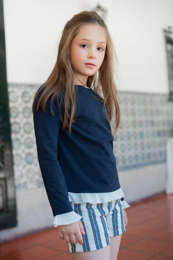 Girl wearing the Candy Shirt Navy for girls by Peter Jo at Nurture Collective