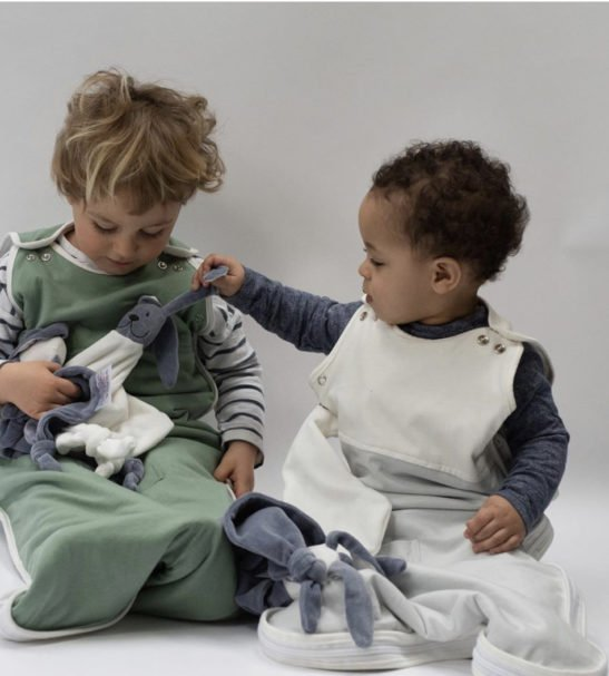 Two Toddlers playing in the Little Earth Baby Sleeping Bags at Nurture Collective