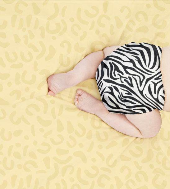 Baby crawling in the BAMBINO MIO MIOSOLO ALL-IN-ONE REUSABLE NAPPY, SAVANNA STRIPES at Nurture Collective