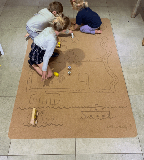 two kids playing on playing on Rocky Road Play mat – Tree foam by Little Earth Baby at Nurture Collective