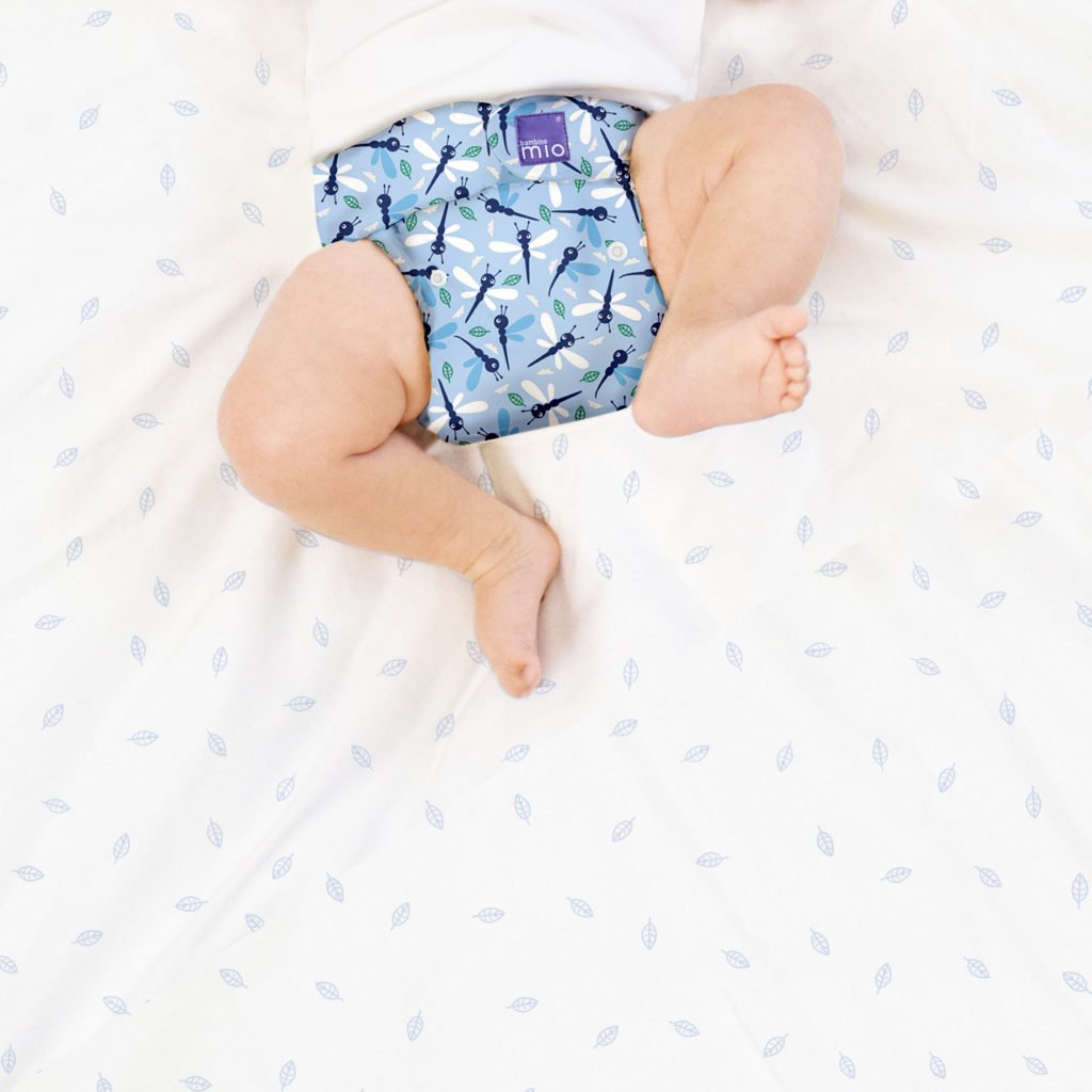 Baby wearing BAMBINO MIO MIOSOLO ALL-IN-ONE REUSABLE NAPPY, Dragonfly Daze at Nurture Collective