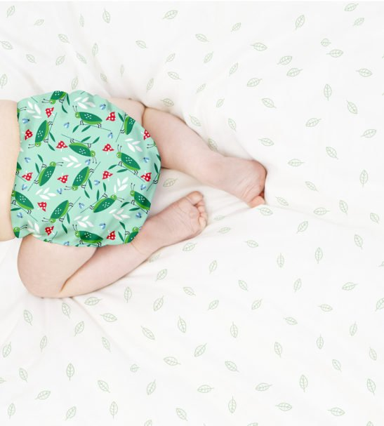 Baby crawling in BAMBINO MIO MIOSOLO ALL-IN-ONE REUSABLE NAPPY, Happy Hopper at Nurture Collective