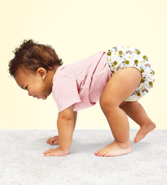 Baby crawling on hands in BAMBINO MIO MIOSOLO ALL-IN-ONE REUSABLE NAPPY, Honey Beehive at Nurture Collective