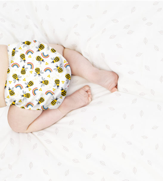 Baby crawling in BAMBINO MIO MIOSOLO ALL-IN-ONE REUSABLE NAPPY, Honey Beehive at Nurture Collective