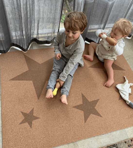 Kids sitting on Star Play mat – Tree foam by Little Earth Baby at Nurture Collective