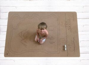 Child kneeling Rocky Road Play mat – Tree foam by Little Earth Baby at Nurture Collective