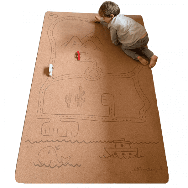 Child playing on Rocky Road Play mat – Tree foam by Little Earth Baby at Nurture Collective
