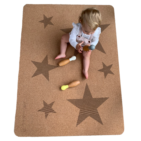Baby sitting on Star Play mat – Tree foam by Little Earth Baby at Nurture Collective