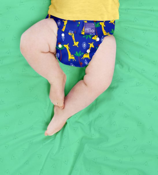 Baby wearing Giraffe Jamboree Print MIOSOLO ALL-IN-ONE REUSABLE NAPPY by Bambino Mio at Nurture Collective