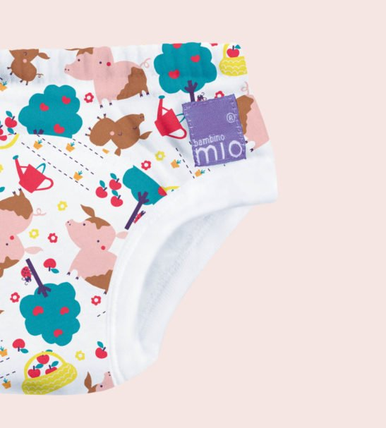 Close up of Puddle Pigs Print Potty Training Pants by Bambinomio at Nurture Collective