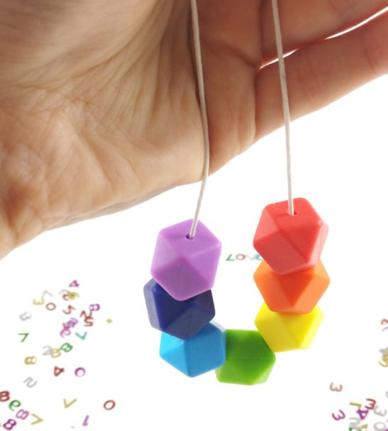 Baby Friendly Geometric Woman holding Silicone Necklace - Rainbow LGTB   New Mum Gift   Nursing necklace by Kodes at Nurture Collective
