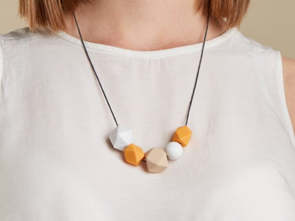Model wearing the Silicone Baby Friendly Necklace - Mustard, Granite & Marble | New Mum Gift | Soother by Kodes at Nurture Collective