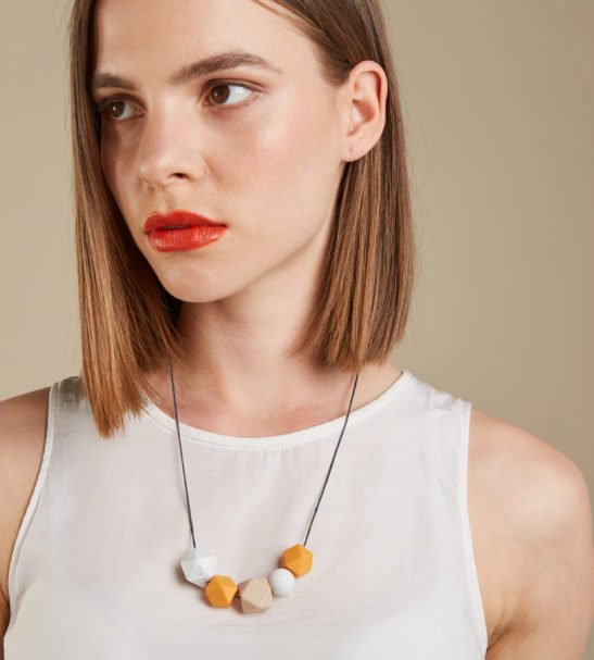 Model wearing Silicone Baby Friendly Necklace - Mustard, Granite & Marble | New Mum Gift | Soother by Kodes at Nurture Collective