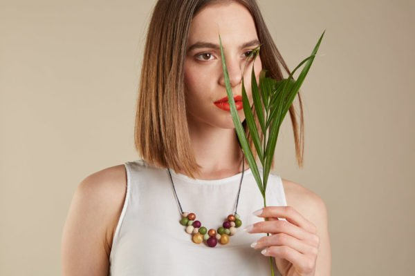 Model Wearing a Baby Friendly Silicone Necklace Mustard Burgundy Lint, New Mum Gift Teething Necklace by Kodes at Nurture Collective