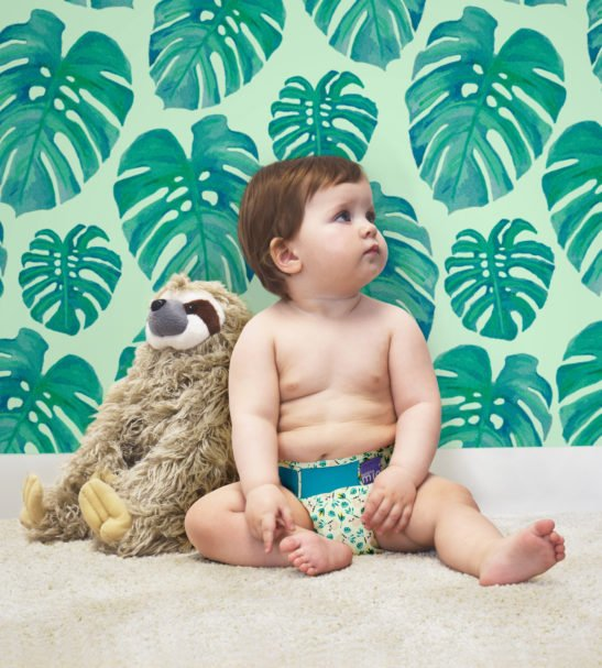 A Baby wearing Swinging Sloth Print Cloth Nappy by Bambinomio at Nurture Collective