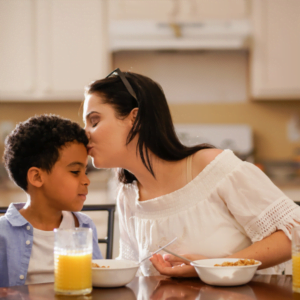 mum and son eating breakfast together sharing a happy moment for Nurture Collective blog