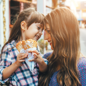 mum and daughter buying ice cream sharing a loving look for Nurture Collective Blog