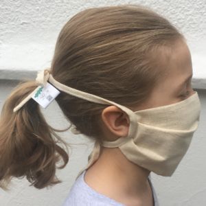 A girl wearing Where Does it Come From Childrens Face Masks at Nurture Collective