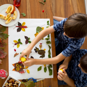 Children doing Leaf Arts and Craft activities for Nurture Collective Blog Tips to Manage Screen Time