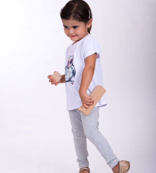 Girl wearing Clever Owl T-Shirt- Unisex in White by Cooee Kids at Nurture Collective