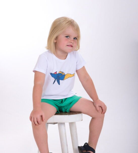 Girl sitting wearing Walkabout Walrus T-Shirt- Unisex in White by Cooee Kids at Nurture Collective