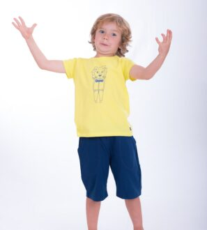 Boy wearing Fiery Lion T-Shirt - Unisex in yellow by Cooee Kids at Nurture Collective