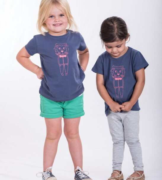Two Girls wearing the Smart Lion T-Shirt - Unisex by Cooee Kids at Nurture Collective
