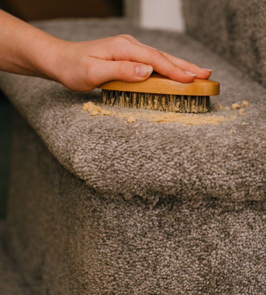 Dry Carpet Cleaner & Wooden Brush cleaning the carpet by Cleaning Living at Nurture Collective