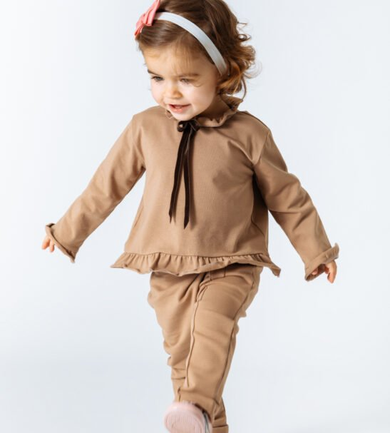 Little girl wearing Shirt Aria in Brown and Pants by Peter Jo at Nurture Collective