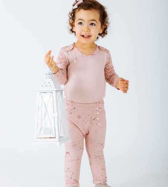 Girl Wearing Body Auriga in Pink and trouser Pants Aries Pink by Peter Jo at Nurture Collective