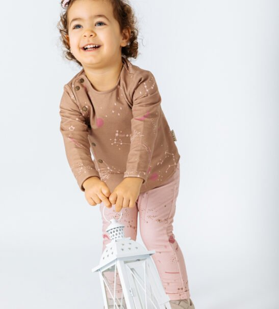 Girl wearing Jacket Phoenix in Brown and Pink leggings by Peter Jo at Nurture Collective