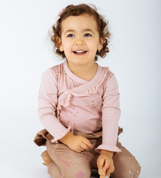 Girl wearing Body Cygnus in Pink and Brown Taurus pants by Peter Jo at Nurture Collective