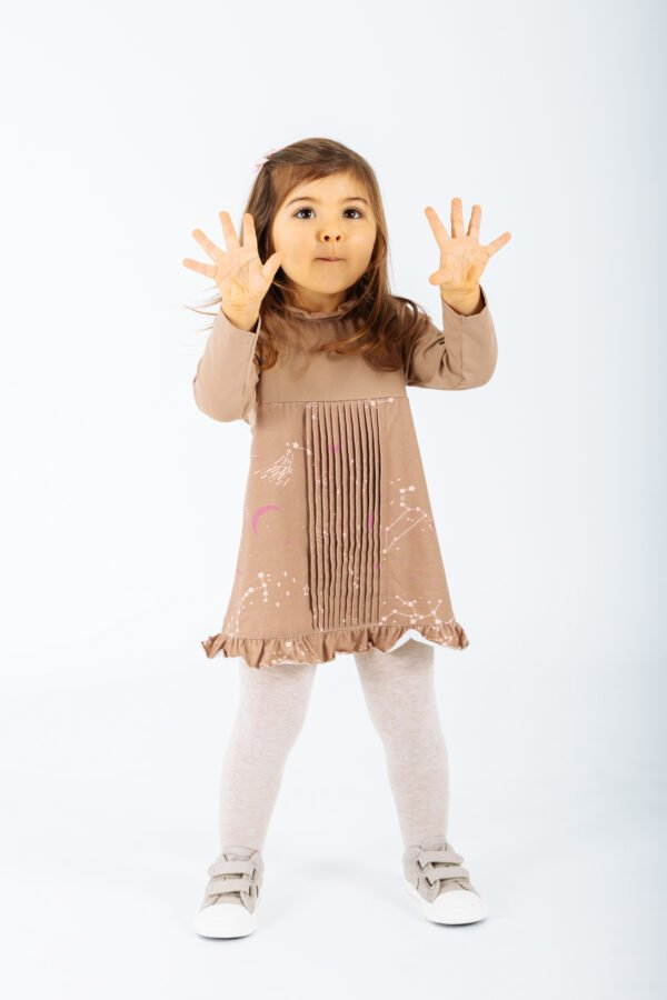 Girl wearing the Dress Antlia in Brown by Peter Jo at Nurture Collective