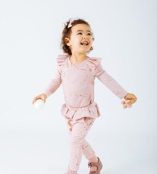 Girl wearing Body Sagitta in Pink and Pink Taurus Pant leggings by Peter Jo at Nurture Collective