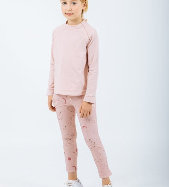 Girl wearing the Shirt Lyra in Pink and the Pants Leo Pink by Peter Jo at Nurture Collective