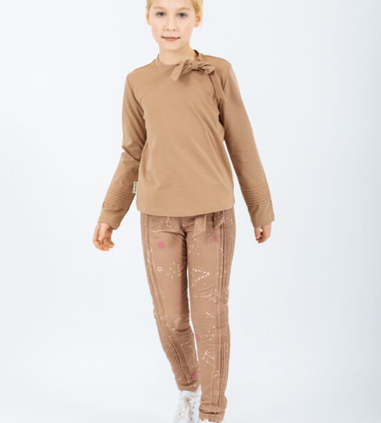 Girl wearing the Shirt Lyra in Brown and Pants Aquarius in Brown by Peter Jo at Nurture Collective