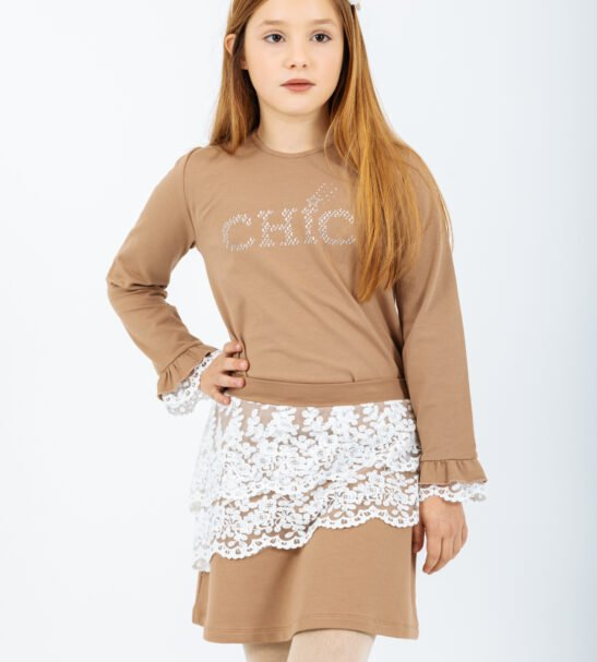 Girl wearing the Shirt Libra in Brown and Pisces Skirt in Brown by Peter Jo at Nurture Collective