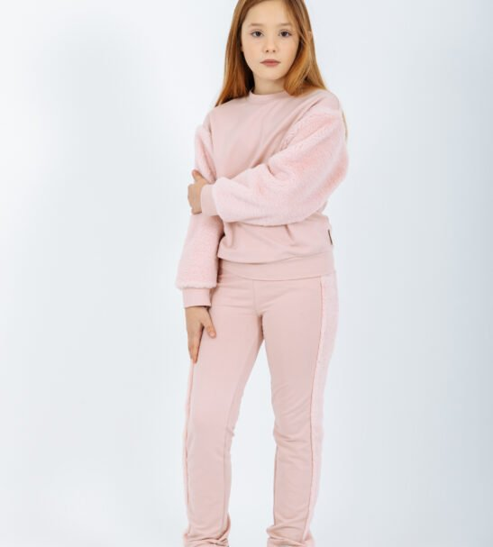 Girl Wearing matching Pullover Carina Sweater in Pink and the Pants Horologium in Pink by Peter Jo at Nurture Collective