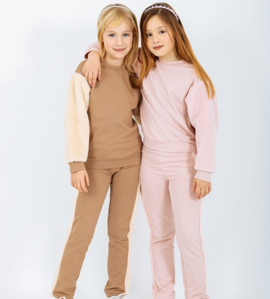 Two Girls one Wearing the Pullover Carina Sweater in Brown and pink matching Pants Horologium in Pink and Brown by Peter Jo at Nurture Collective