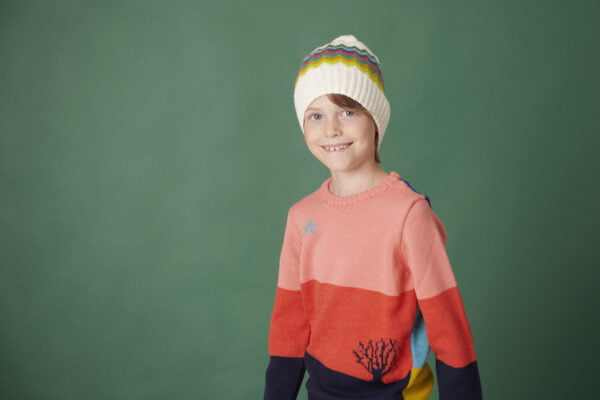 Boy wearing the Navigator Wolly Hat in White The Star Gazer Jumper in Pink Combo by The Faraway Gang at Nurture Collective